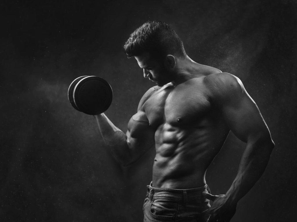 a man lifting a dumbbell