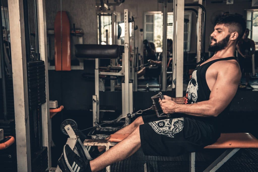 a man doing seated cable row